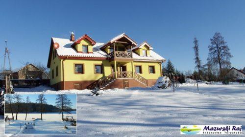 Dom zasypany śniegiem; widok na jezioro zasypane śniegiem.
